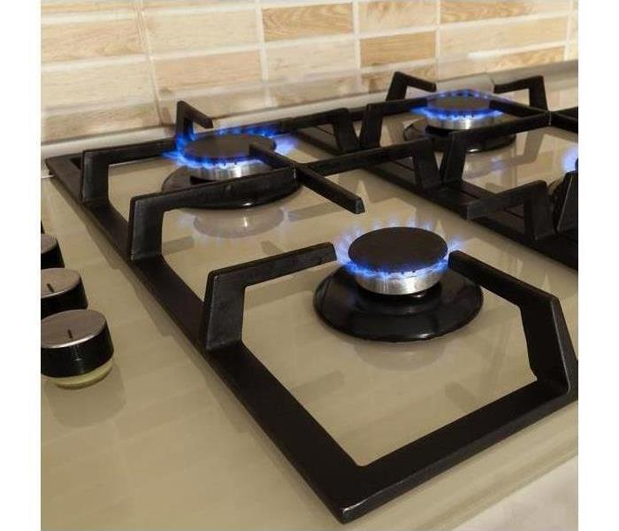 Gas stove with flames